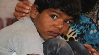 عائلة سورية، تنتظر تحرير عفرين لاحتضان تراب طفلهم المدفون فيها