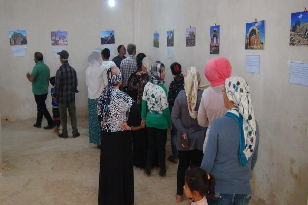 Delegations watch photos of the Turkish aggression at exhibition in