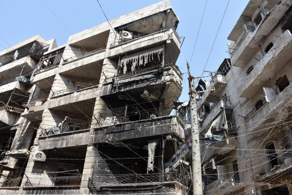 What did gangs do in corpses of its elements in al-Ashrafieh neighborhood?