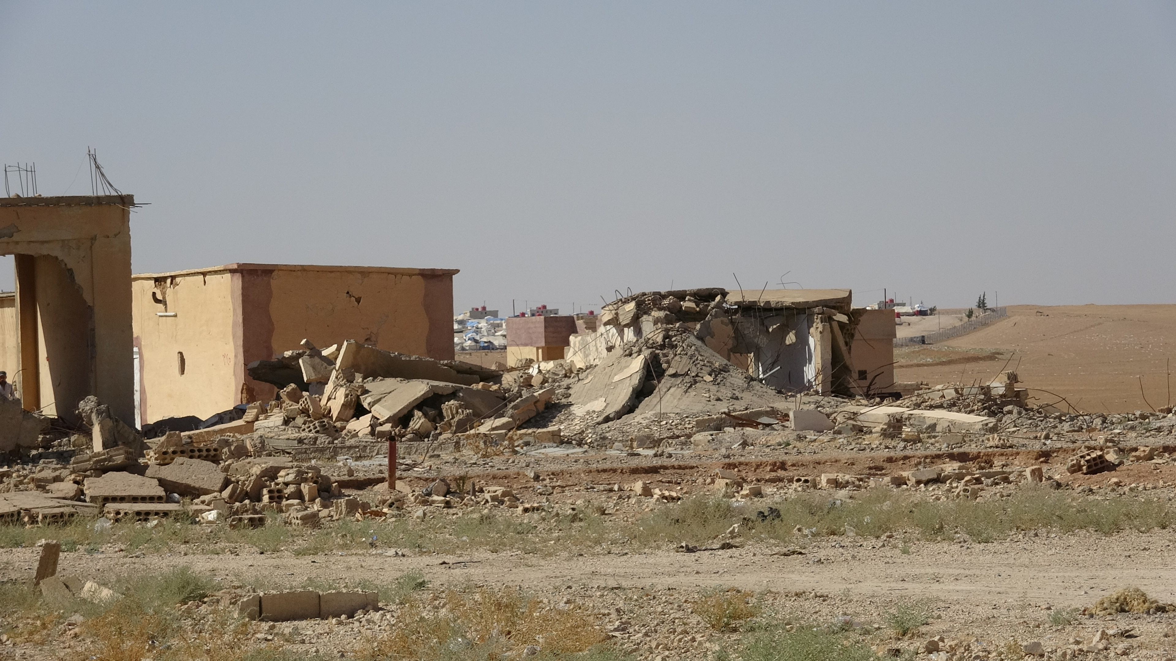 Double efforts of Ain Issa people to rebuild their district