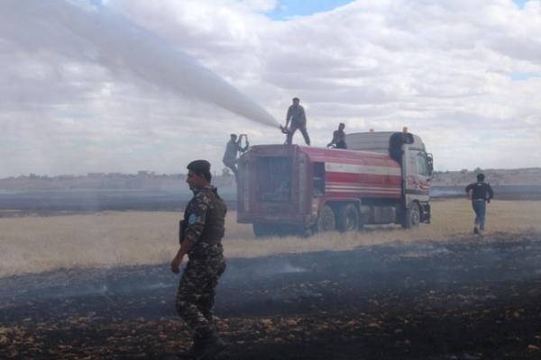 Fire and emergency teams protect people's crops, put out fire in Al Shaddadeh