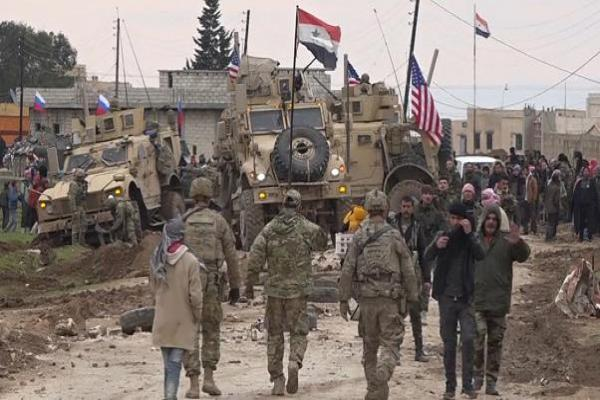 Tal Tamr Military Council prevents a possible infighting between an American convoy and a Syrian government forces' checkpoint