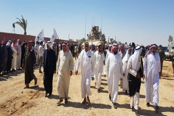 Clans of the Akidat tribe meet in the countryside of Deir Ezzor