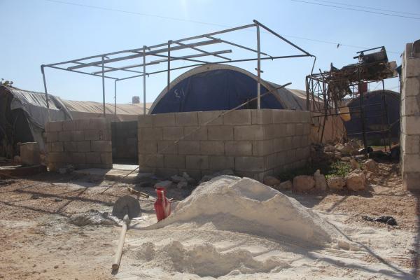 Efrînli göçmenler kamplarda kış hazırlığı yapıyor
